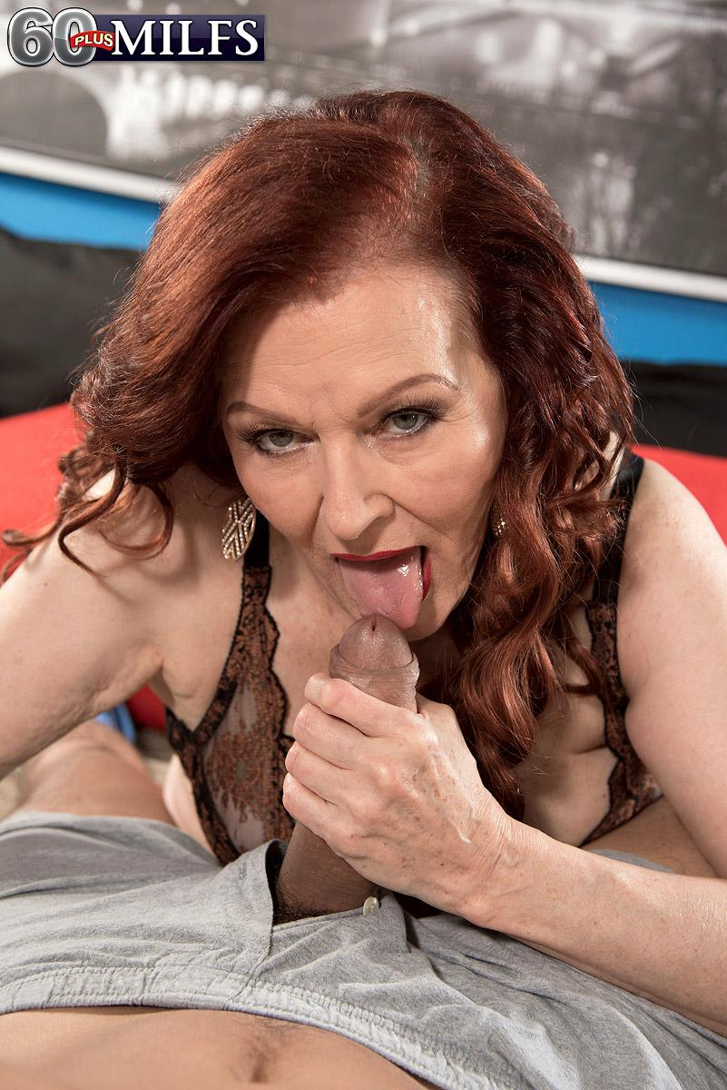 Redheaded 60 plus MILF escort Katherine Merlot providing humungous prick handjob and oral pleasure