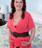 Redhead 60 MILF tangles  with black and white boys at the same time