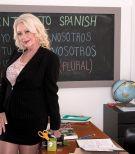 Stocking and skirt adorned 60 plus MILF teacher unleashing massive hooters