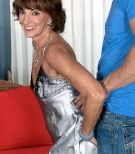Leggy granny is relieved of satin lingerie during foreplay with a young Latino boy