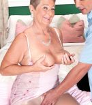 Plump granny Joanne Price loosing huge hooters before giving massive boner blowjobs in nylons