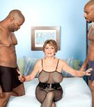 Bosomy Sixty plus MILF Bea Cummins jerking BIG EBONY DICK in bi-racial threesome sex festival