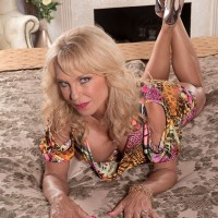 Hot over 60 MILF Cara Reid lets her huge granny hooters loose from bra