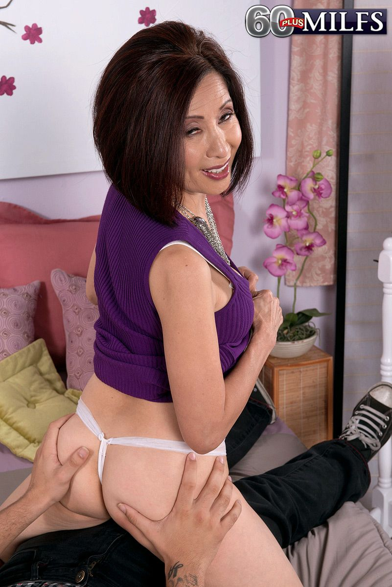 Hot over 60 Asian MILF Kim Anh showing a younger man sex tricks in bedroom