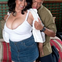 Mature pornstar Rochelle Sweet having big natural breasts exposed by younger stud