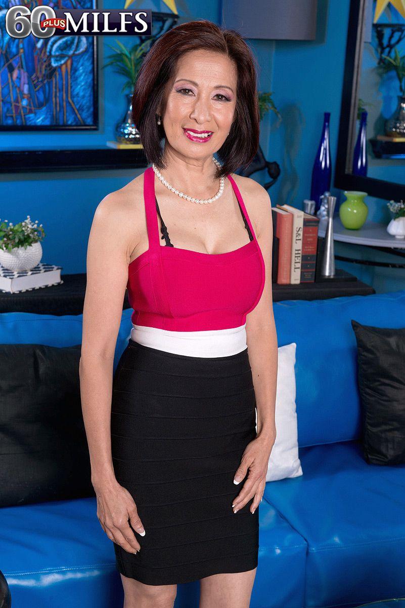 Slim Oriental granny Kim Anh stripping down to skimpy bra and panty set