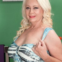 Busty blonde granny Angelique DuBois giving head to younger man in bedroom