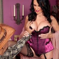Over 60 granny Rita Daniels poses in seductive lingerie and pantyhose