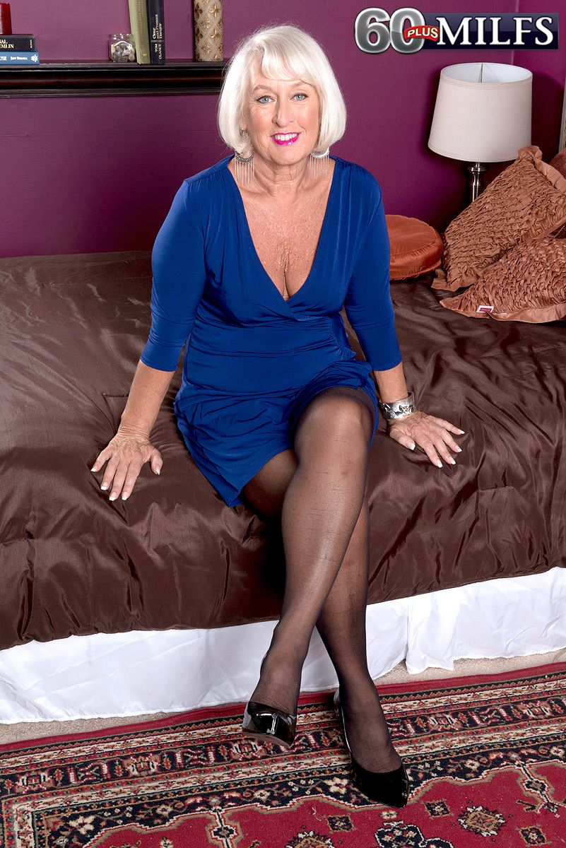 Over sixty model Jeannie Lou flashing pink pussy under crotchless pantyhose