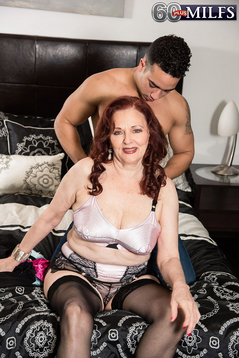 Mature redhead Katherine Merlot exposing large boobs for younger man seduction