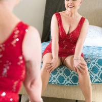 Hot older woman Jewel striking sexy poses in pantyhose