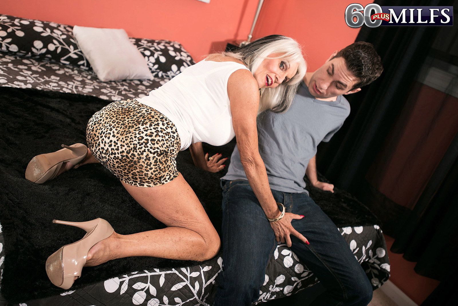 Big boobed over 60 GILF Sally D'Angelo flashing panties under cougar print skirt