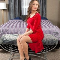Over 60 granny Mona posing in red dress and pantyhose before having sex