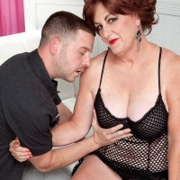 Busty over 60 model Gabriella LaMay getting ready to suck younger man's cock
