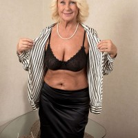 Over 60 granny porn model Regi stripping down top black nylons and underwear