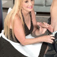 Mature blonde lady over 60 giving younger man's large cock CFNM blowjob