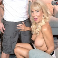 Busty over 60 blonde babe receives oral sex from young man in high heels