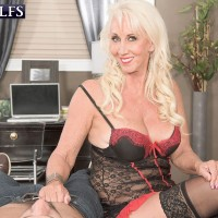 Stocking and lingerie adorned blonde MILF over 60 jerking off cock
