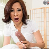 Over 60 Asian pornstar Kim Anh baring nice mature boobs while jerking off dick