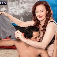 Over 60 pornstar Katherine Merlot giving handjob in lingerie and high heels