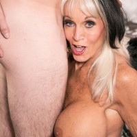 Leggy mature pornstar flashing upskirt panties before baring big tits and giving bj