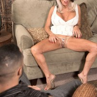 Mature pornstar flashes panties before exposing big tits for tit fucking on knees
