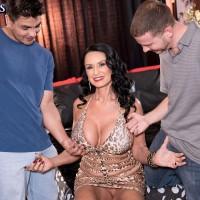 Busty brunette mature MILF pornstar freeing huge knockers in MMF threesome