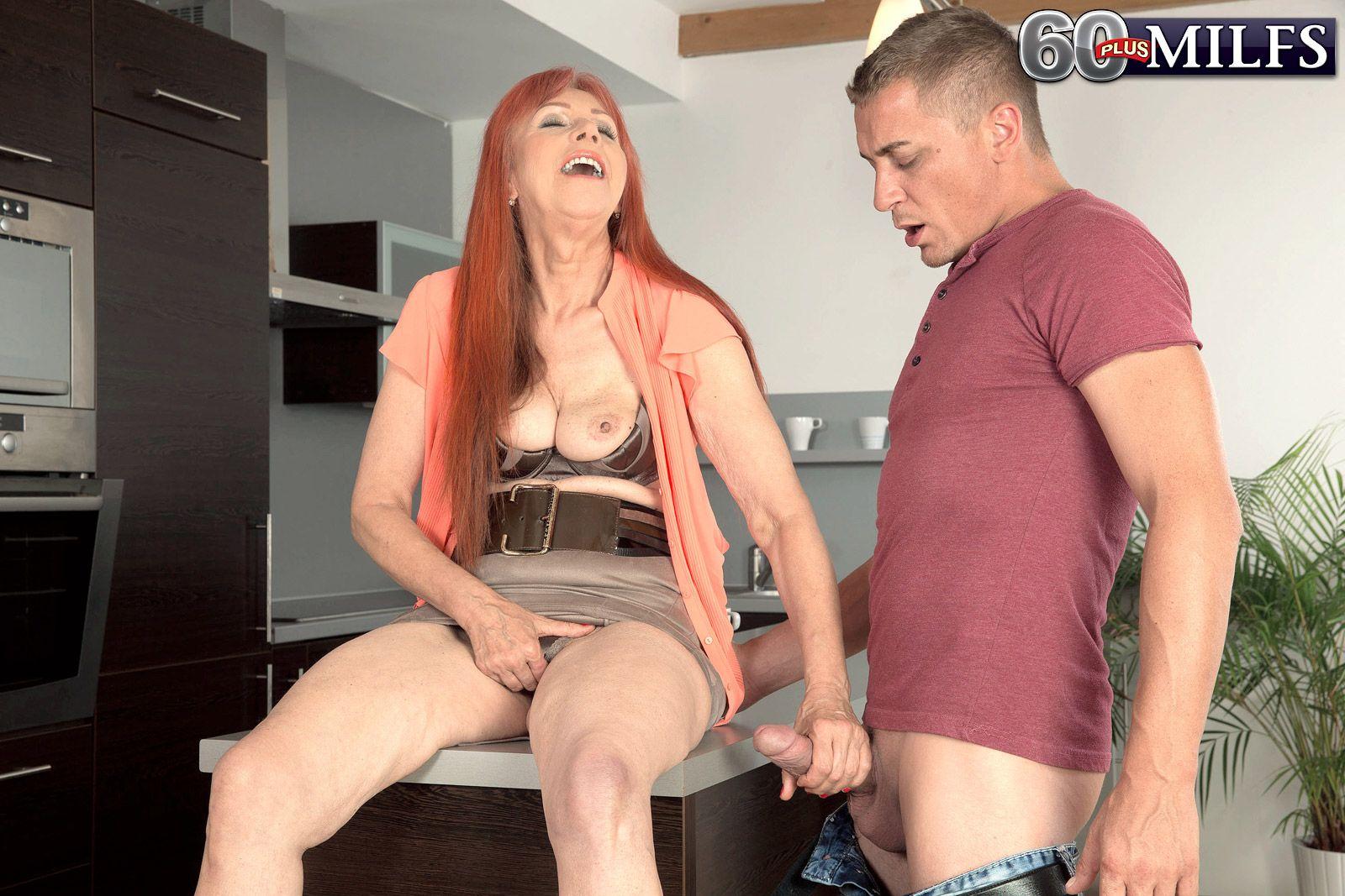 Busty redhead over 60 porn model Charlotta having nice granny tits fondled
