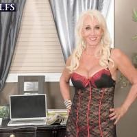Over 60 porn model Madison Milstar giving a handjob in sexy lingerie