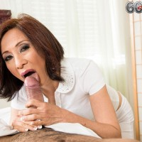 Petite Asian pornstar over 60 Kim Anh giving thick cock handjob