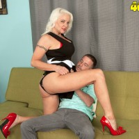 Bosomy over 60 pornstar Veronica Vaughn riding younger cock in red high heels