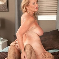 Chesty blonde GILF Alice exposing big all natural tits for younger man