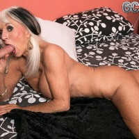 Chesty pornstar over 60 Sally D'Angelo flashing panties and giving a blowjob