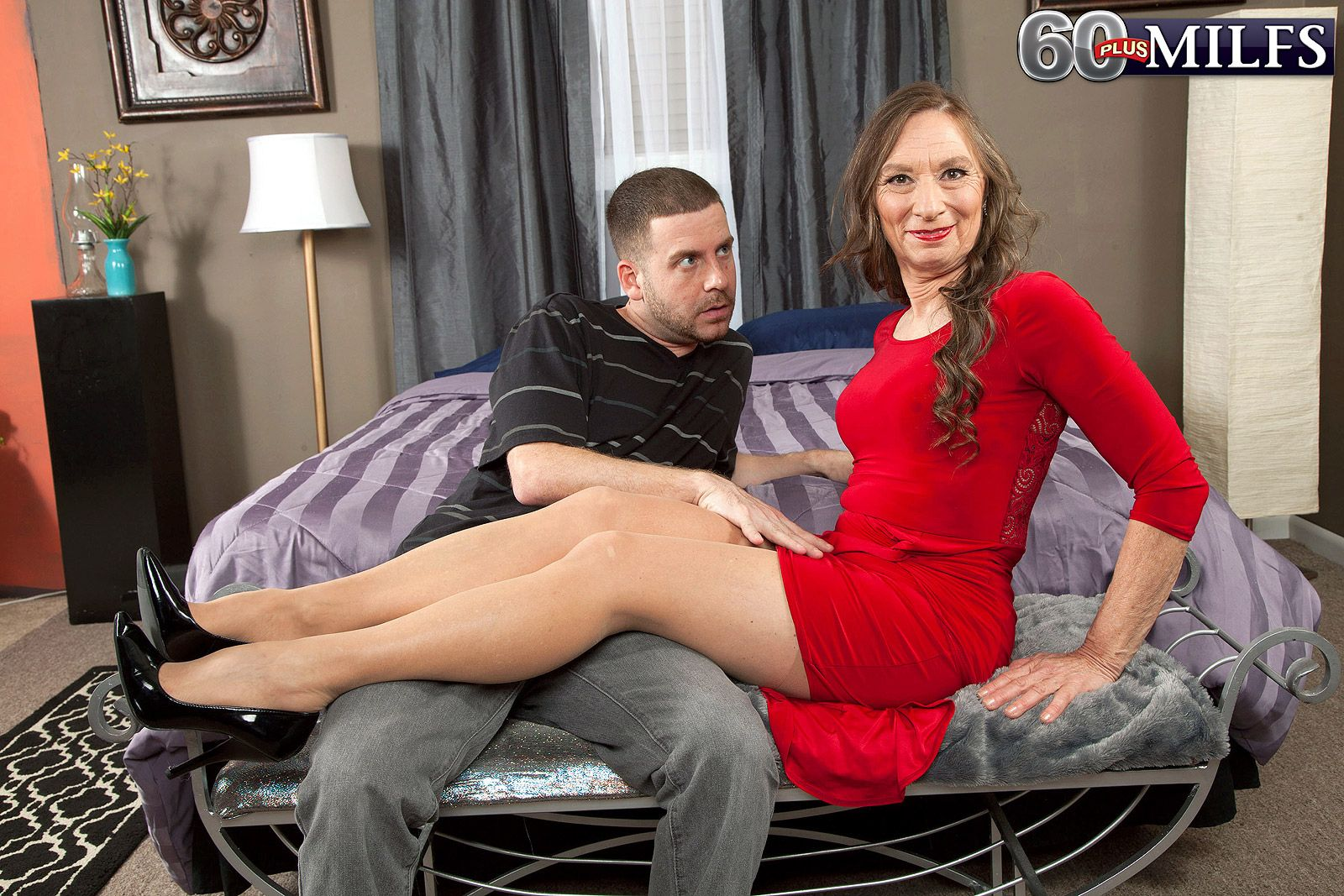 Over 60 porn model Mona posing in pantyhose and heels before sex with younger man