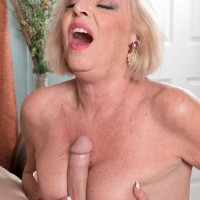 Over 60 blonde pornstar Scarlet Andrews getting tit fucked by long cock