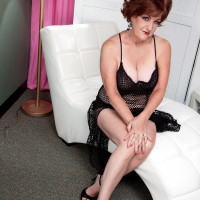 Busty 60plusmilfs model Gabriella LaMay modeling in fishnet dress and underwear