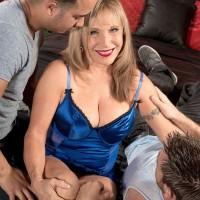 Over 60 blonde pornstar Luna Azul baring big mature tits beneath lingerie in MMF 3some