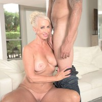 60 plus MILF with great legs is stripped to her birthday suit by a younger man