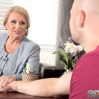 Thick older blonde seduces a younger gentleman while he visits her office place