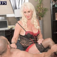 Platinum blonde granny works nice tits free of sexy lingerie before jerking a BBC