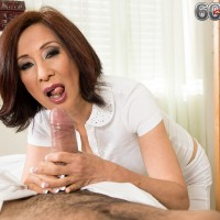 Sexy 60 plus Asian nurse takes care of a younger patient's throbbing penis