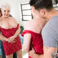Horny 60 MILF checks herself out in a mirror before tempting a young Latino boy