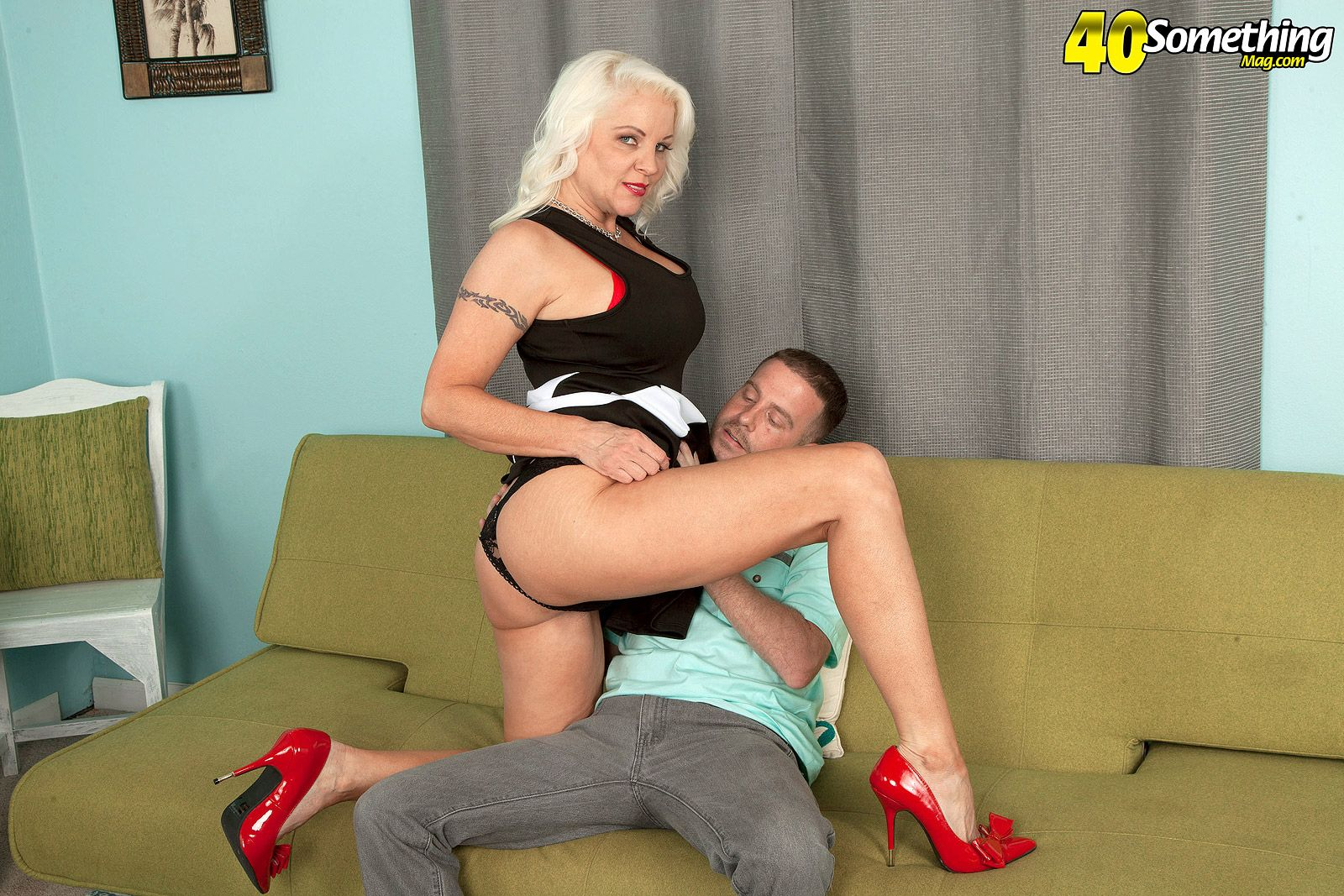 Over 60 lady with great tits and a firm ass seduces a younger man in red pumps