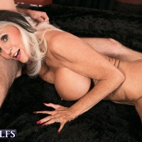Top granny pornstar Sally D'Angelo takes a younger boy's big cock in her mouth
