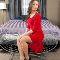 Over 60 GILF awaits her younger boyfriend in a red dress and flesh colored hose