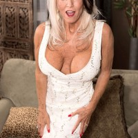 Big titted over 60 pornstar takes a big black in hand as she readies for a blowjob