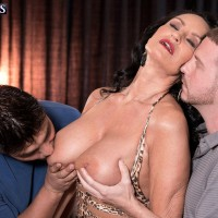 Hot mature woman has her great boobs played with by a couple of younger men