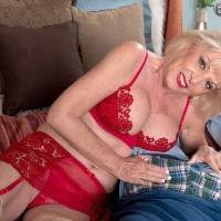 Over 60 blonde tit fucks her younger lover's big cock during POV action