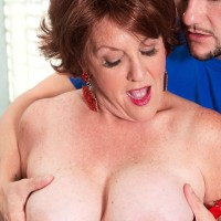 Redhead GILF with large breasts exchange oral sex with a younger dude