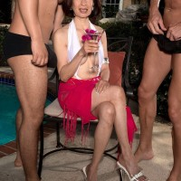 Sexy Asian granny bangs a couple of hung studs by an outdoor swimming pool